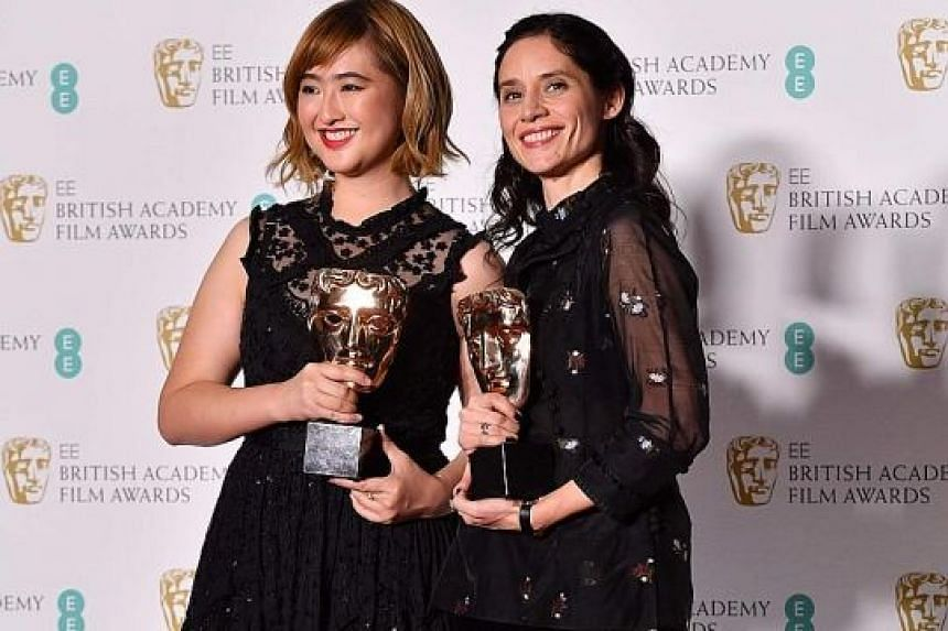 Producer Low Ser En and British director Paloma Baeza (both above) with their awards for the film Poles Apart at Royal Albert Hall in London on Sunday.