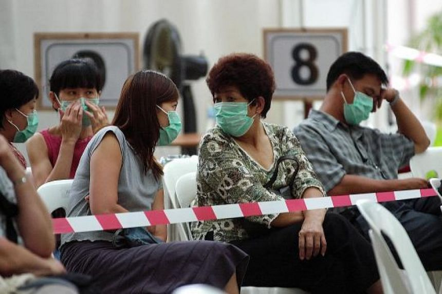 Patients waiting to be screened at Tan Tock Seng Hospital during the Sars outbreak in 2003. The purpose of the study by the School of Public Health was to discover public acceptance of different outbreak response policies.
