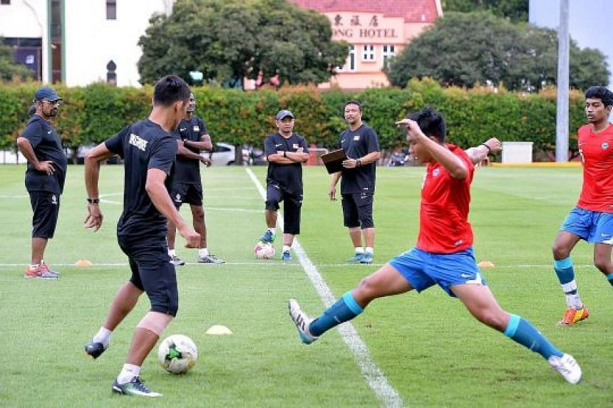 Fandi Ahmad (third from right) at his first training session with the Young Lions. He revealed that 12 of the players admitted that they were smokers.