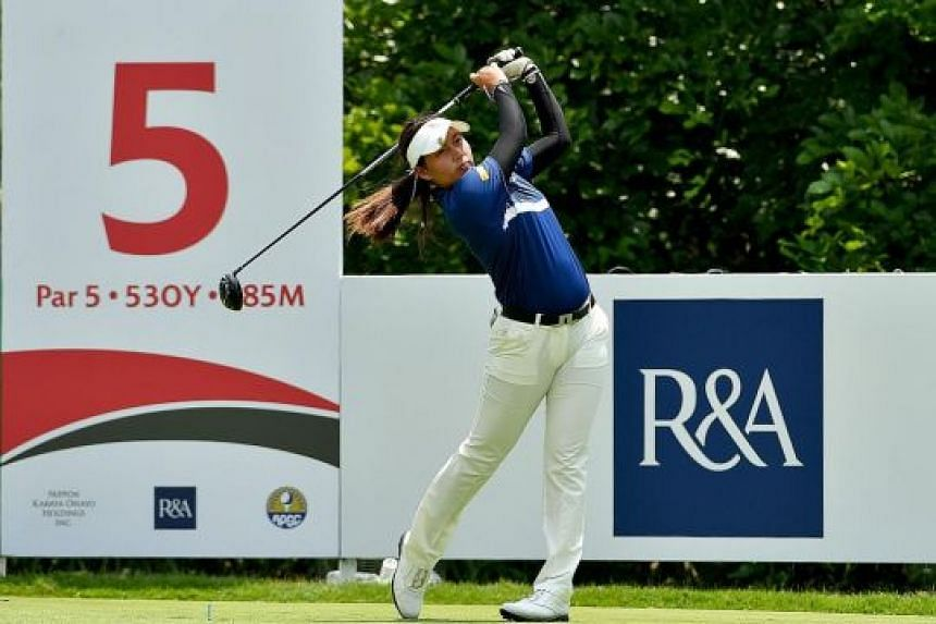 Thai golfer Atthaya Thitikul on her way to firing an opening six-under 65 yesterday to lead the Women's Amateur Asia-Pacific golf championship. The 15-year-old has been in remarkable form, becoming the world's youngest winner on any professional golf