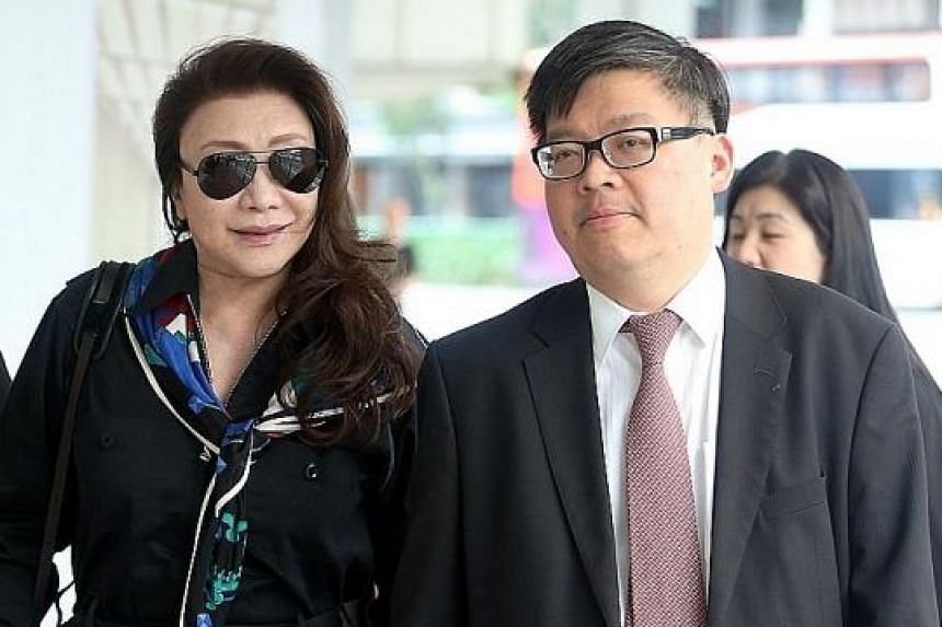 Shi Ka Yee, 72, arriving at the State Courts with her lawyer lrving Choh for the hearing yesterday.