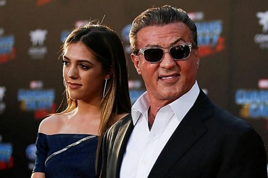 Online rumours said actor Sylvester Stallone (right, with his daughter in an April 2017 photograph) had died following a battle with prostate cancer.