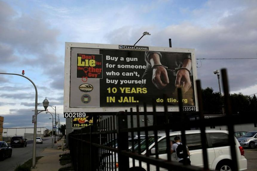 A billboard displaying advice not to buy a gun for someone else on display in Chicago on Oct 31, 2017.