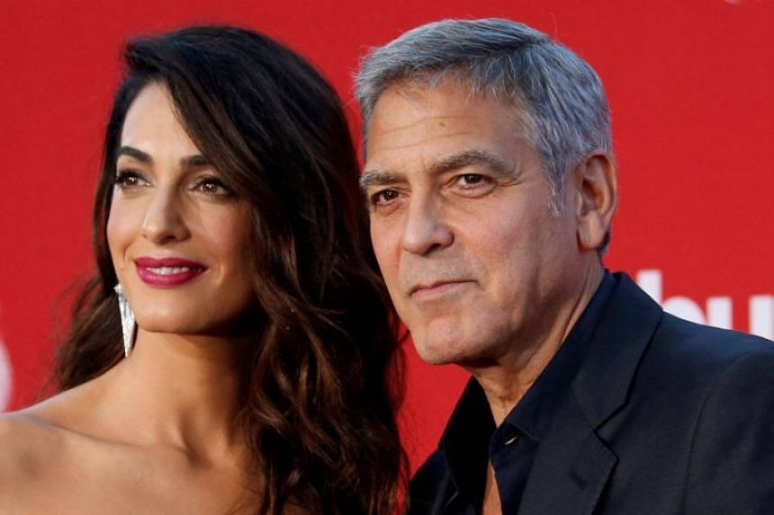 George Clooney prompted a fresh round of speculation about his possible political ambitions when he announced that he and his wife, Amal, would be donating US$500,000 to next month's gun-rights march.