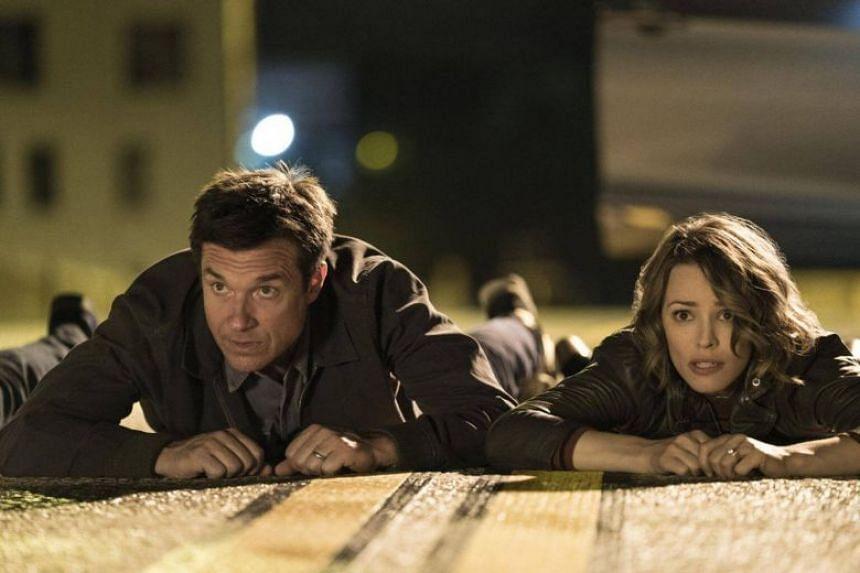 Jason Bateman and Rachel McAdams as Max and Annie in Game Night.