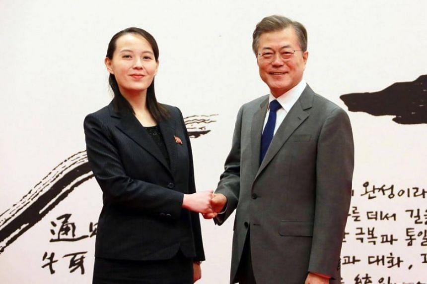 South Korea's President Moon Jae In posing with North Korean leader Kim Jong Un's sister Kim Yo Jong before their meeting at the presidential Blue House in Seoul.