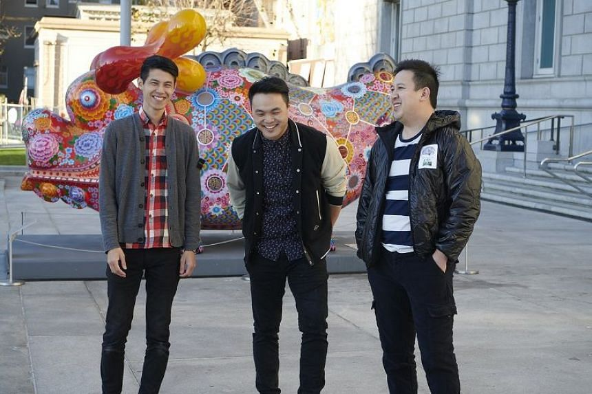 Chef Deuki Hong (centre), with Bin Chen (left) and Andrew Chau, founders of Boba Guys, an artisanal bubble-tea chain, by Taiwanese artist Hung Yi's sculpture Dragon Fortune outside the Asian Art Museum in San Francisco, Feb 15, 2018.
