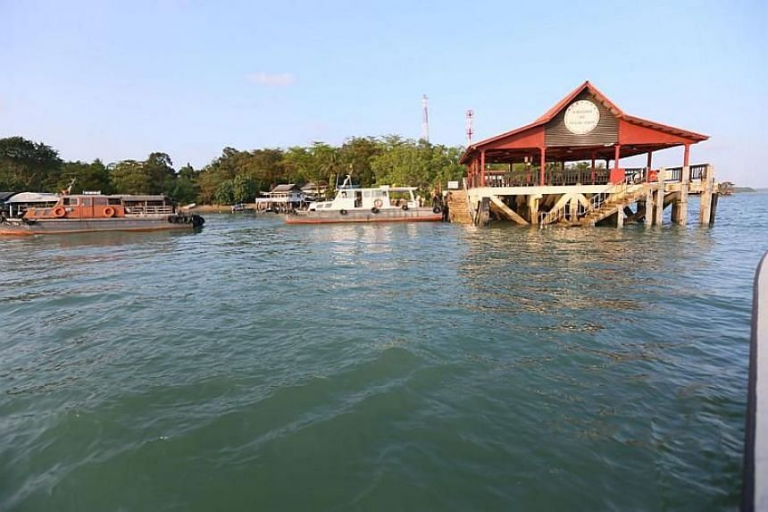Police arrested Chew Eng Han and Tan Poh Teck on board a motorised sampan from the main jetty on Pulau Ubin at 8.47am on Feb 21, 2018.