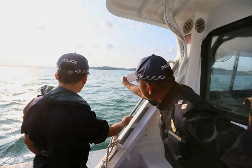Police officers indicating the spot, about 2.4km away from the Pulau Ubin Jetty, where the Coast Guard picked up Chew Eng Han on Feb 21, 2018.