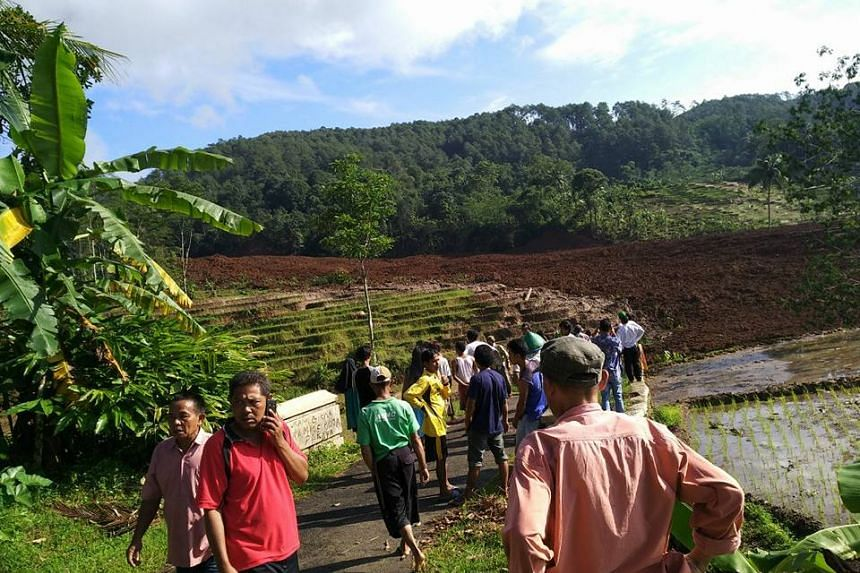 Residents gathering at the site of a landslide at a rice terrace which left 14 injured and 11 missing, in Brebes district in central Java, on Feb 21, 2018.