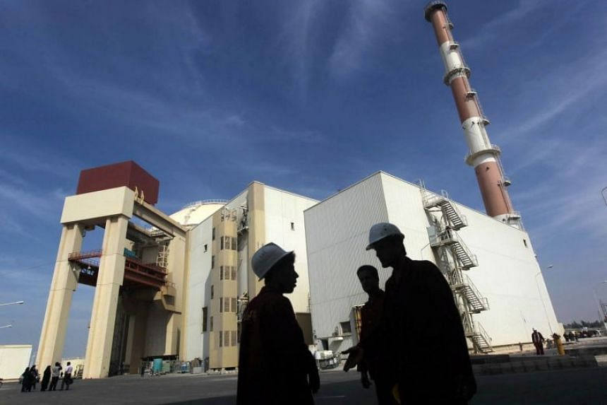 Iranian workers standing in front of the Bushehr nuclear power plant, about 1,200 km south of Teheran, Iran.
