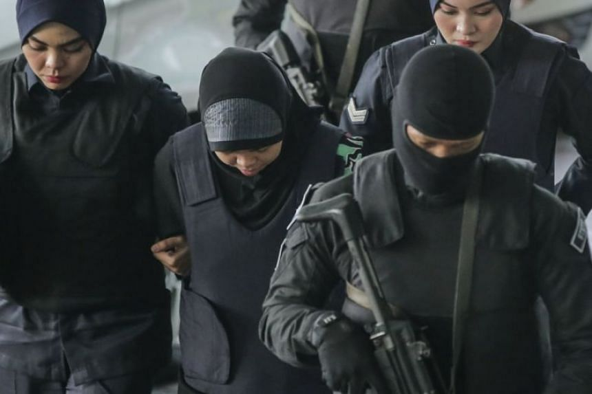 Indonesian Siti Aisyah (second from left) is escorted by Malaysian police officers as she arrives at the Shah Alam High Court, Shah Alam, Malaysia, on Feb 22, 2018.