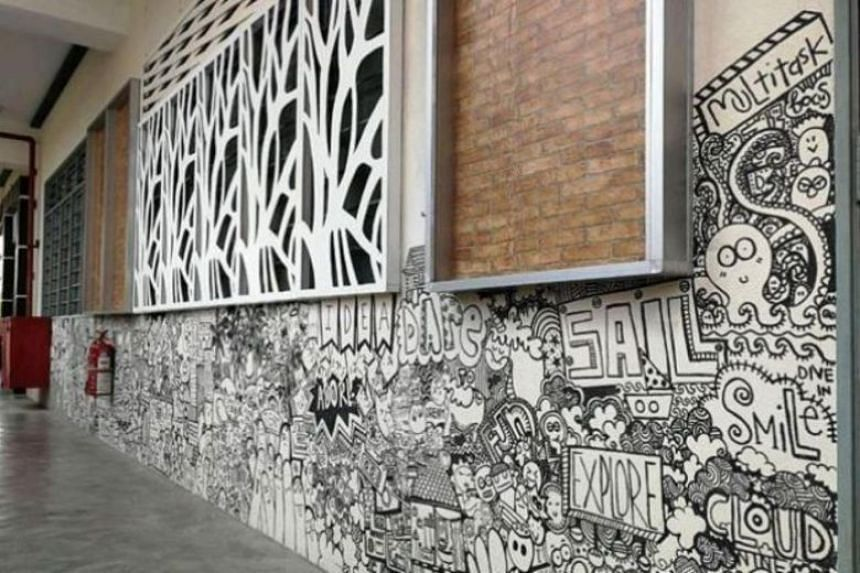 Ms Sarah Muhammad Fauzi's doodles are drawn with a whiteboard marker on the walls of SK Sri Pulai Perdana in Johor Baru.