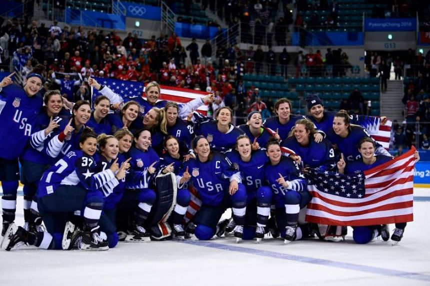 The US team celebrates winning the women's gold medal ice hockey match against Canada during the Pyeongchang 2018 Winter Olympic Games at the Gangneung Hockey Centre om Feb 22, 2018.