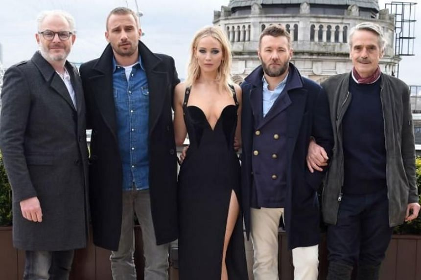 The picture, taken outdoors on a bitter winter's day in London earlier this week, showed a bare-shouldered Jennifer Lawrence in a black Versace gown, while her fellow cast members donned thick wool coats.