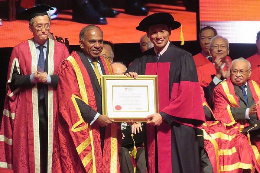 NTU's fourth president, Professor Subra Suresh, receiving his certificate of appointment from Minister for Education (Higher Education and Skills) Ong Ye Kung.