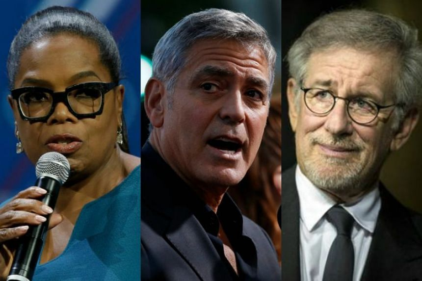 (From left) Oprah Winfrey, George Clooney and Steven Spielberg made financial pledges to support The March For Our Lives event on March 24, 2018.