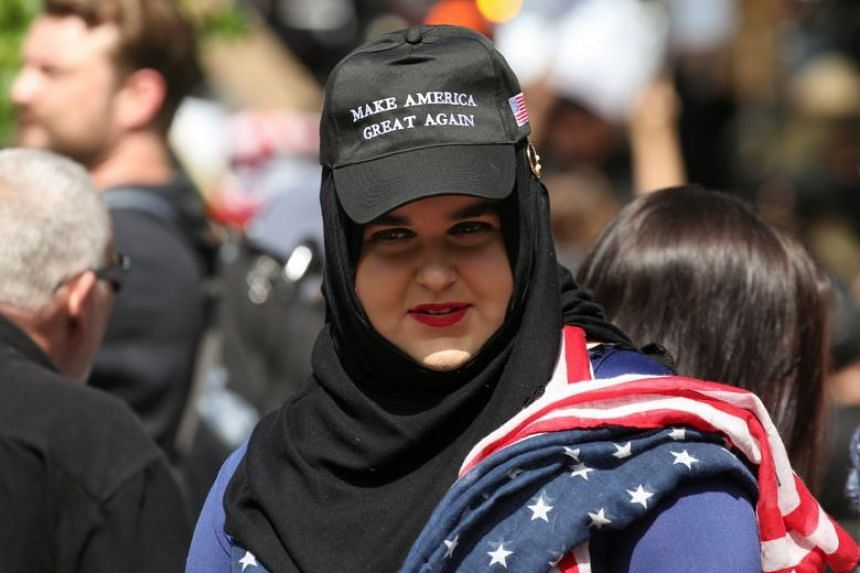 An attendee wears a hijab and a pro-Trump cap during an anti-Sharia rally in Seattle, in June 2017.