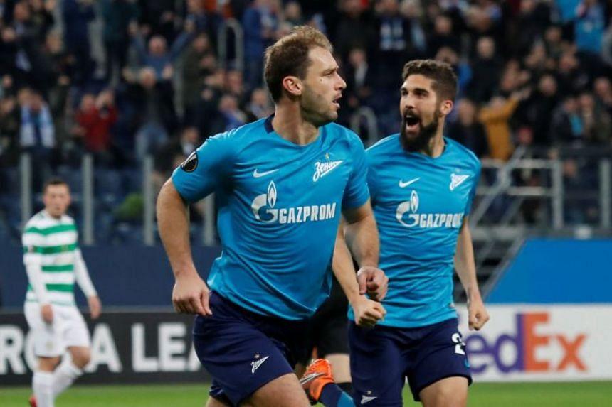 Branislav Ivanovic celebrates scoring their first goal.