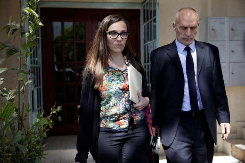 Oxfam officials leave after a meeting with Haiti's Minister of Planning and External Cooperation in Port-au-Prince.