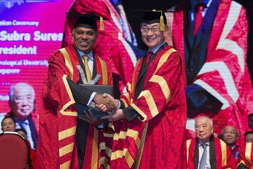NTU president Subra Suresh receiving his conferment as distinguished university professor from Mr Koh Boon Hwee, chairman of the NTU board of trustees, at the inauguration ceremony at the university's Nanyang Auditorium yesterday.