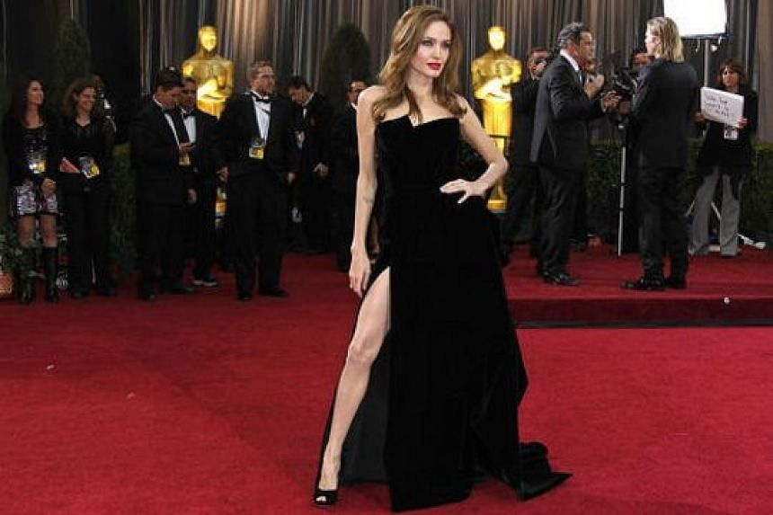 Other celebrities who have made headlines with their outfits include R&B queen Beyonce in Givenchy in 2015, singer-actress Jennifer Lopez in Versace in 2000 and actress Angelina Jolie (above) in Versace in 2012.