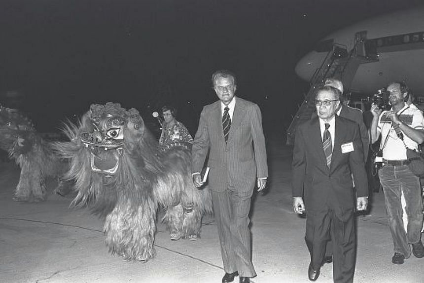 Dr Billy Graham was greeted by lion dancers when he arrived in Singapore in 1978 to preach over five nights at the old 55,000-seat National Stadium in Kallang. The National Council of Churches of Singapore said 337,000 people, including Singaporeans