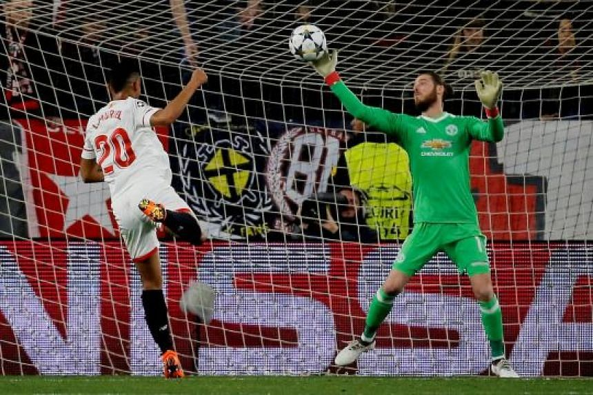 Manchester United's David de Gea pulling off a reflex, point-blank save from Sevilla's Luis Muriel in their 0-0 first-leg Champions League game in Seville on Wednesday. The hosts had 25 shots to United's six.