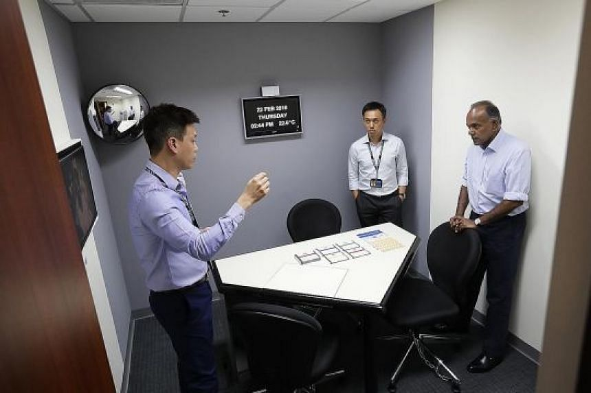 Home Affairs and Law Minister K. Shanmugam viewing the interview room where statements will be recorded on video and can be used in court processes.