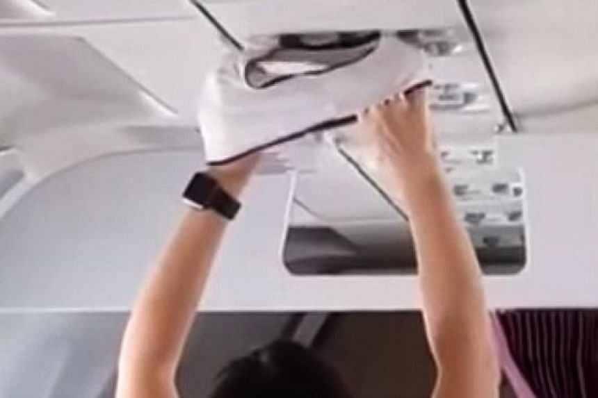 In a video that has been shared widely online, the woman is seen holding her underwear overhead while seated during her Moscow-bound flight. She moves it around just below the air vents, and even flips it a few times.