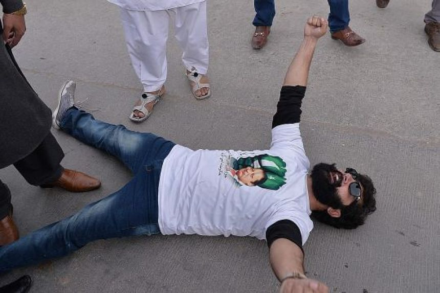 A supporter of ousted Pakistani prime minister Nawaz Sharif protesting against the Supreme Court verdict yesterday outside a court where Sharif arrived to face corruption charges in Islamabad.