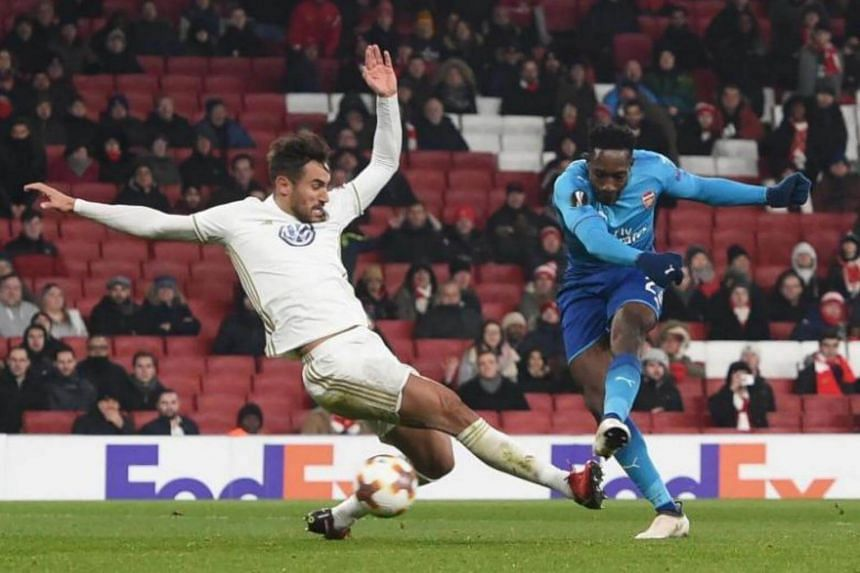 Arsenal's Danny Welbeck (right) in action during the match between Arsenal FC and Ostersunds FK at the Emirates Stadium in London on Feb 22, 2018.