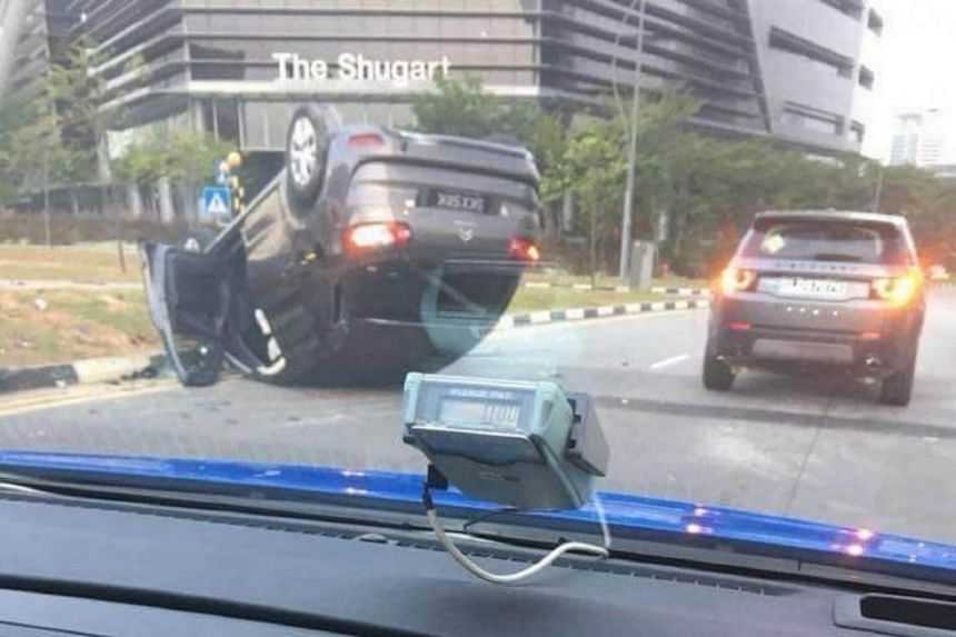 The overturned car in Ayer Rajah, near the Mediacorp Campus, on Feb 23, 2018.