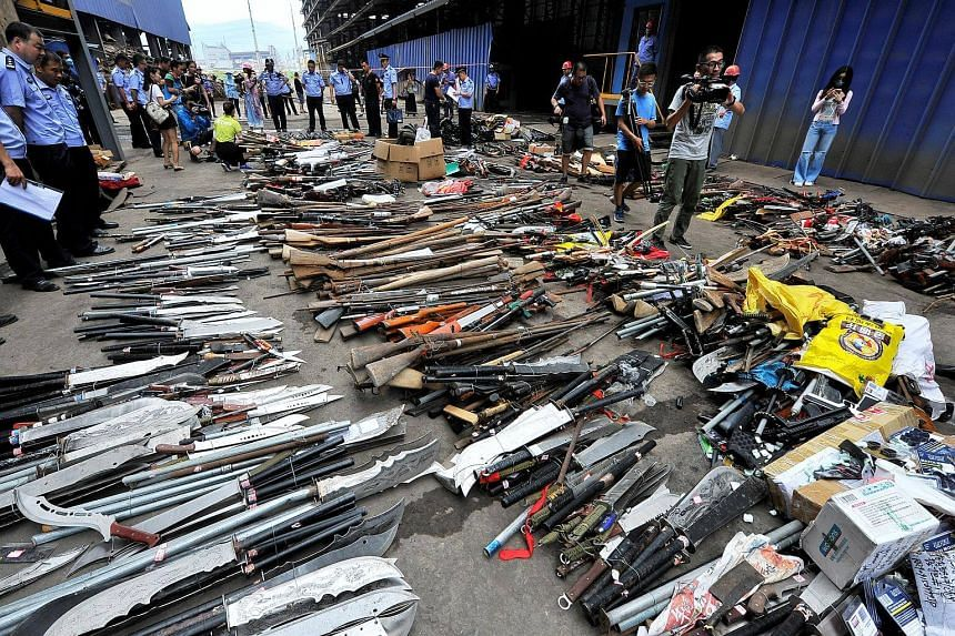 Illegal weapons captured by local authorities and discarded legal guns are displayed before being destroyed at a steel factory in Fujian, China on July 5, 2017.