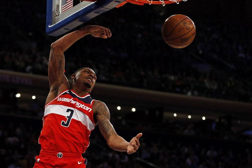 Washington Wizards guard Bradley Beal dunks the ball against the New York Knicks in the first half during their game at Madison Square Garden, on Feb 14, 2018.