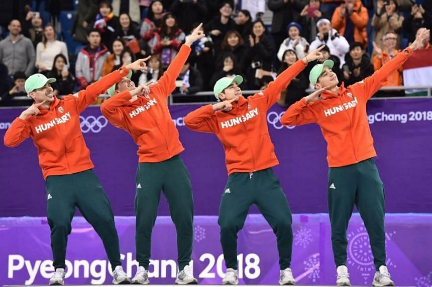 Hungary celebrate their gold medal on the podium at the men's 5,000m relay short track speed skating venue ceremony during the Pyeongchang 2018 Winter Olympic Games.