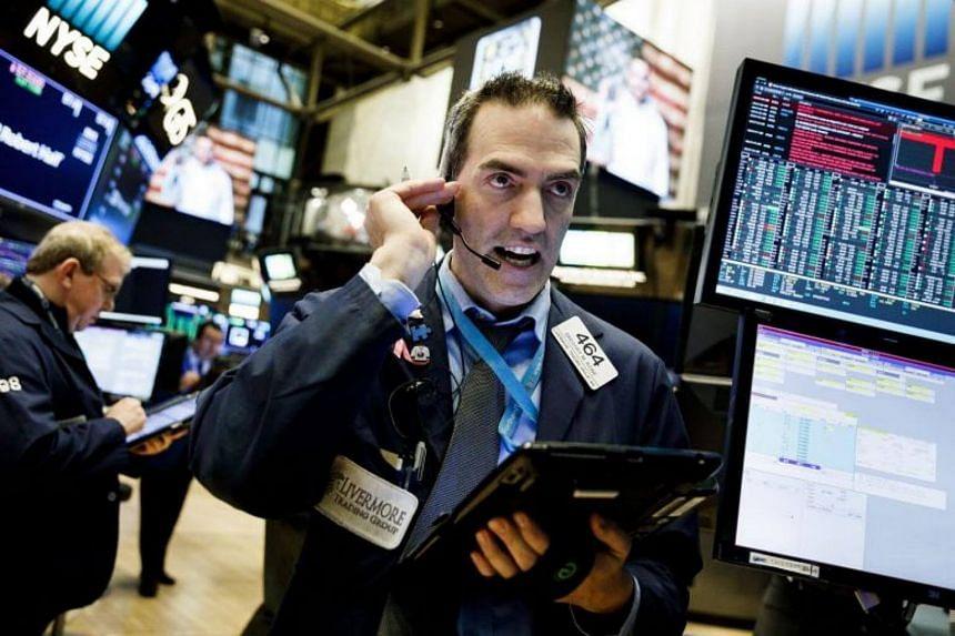 Traders work on the floor of the New York Stock Exchange, Feb 22, 2018.