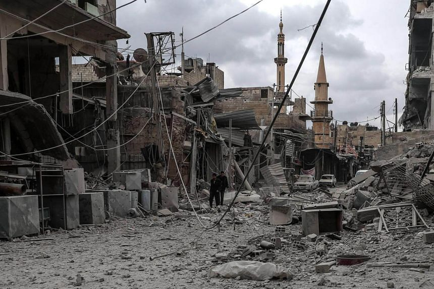 A building and a street that were bombed on the same day in rebel-held Douma in Syria on Feb 22, 2018.