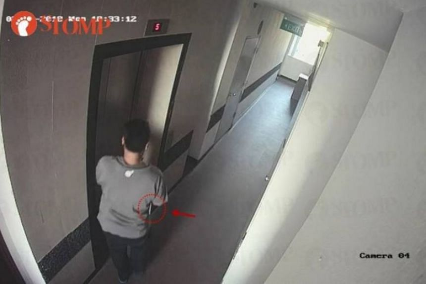 The CCTV footage shows the man appearing to be picking something up from the floor before quickly entering the lift with a white package barely seen tucked under his right arm.