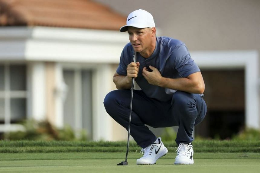 Noren lines up his putt on the 13th green during the first round of the Honda Classic.
