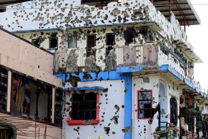 A bullet-riddled apartment house located in a residential area in Malutlut district, Marawi city, on Oct 27, 2017. The house was believed to have been rented by militant leaders Isnilon Hapilon and Omar Maute before their battle in Marawi City.