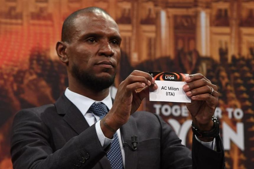 Barcelona and Lyon's former player Eric Abidal shows the name of AC Milan during the draw for the round of 16 of the UEFA Europa League football tournament at the UEFA headquarters in Nyon, Switzerland on Feb 23, 2018.