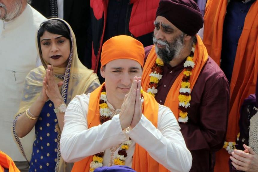 Canadian Prime Minister Justin Trudeau (centre), Bardish Chagger (left), Canadian Minister of Small Business and Tourism along with Canadian Minister of Defence, Harjit Singh Sajjan (right), during their visit to the Golden Temple in Amritsar, India,