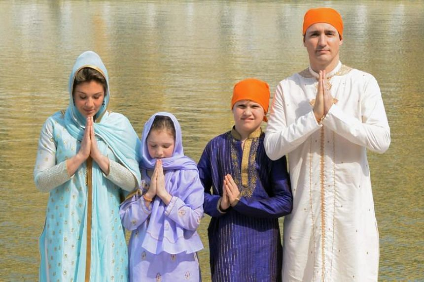 Canadian Prime Minister Justin Trudeau (right) along with his wife Sophie Gregoire Trudeau (left) daughter Ella-Grace (second from left) and son Xavier (second from right) pay respects at the Sikh Shrine Golden temple in Amritsar on Feb 21, 2018.