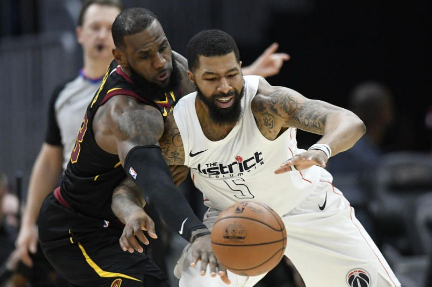 Cleveland Cavaliers forward LeBron James knocks the ball from Washington Wizards forward Markieff Morris in the third quarter at Quicken Loans Arena.