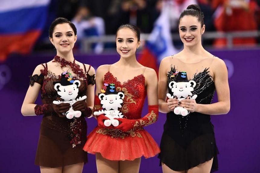 (From left) Silver medallist Evgenia Medvedeva, gold medallist Alina Zagitova and bronze medallist Kaetlyn Osmond during the venue ceremony at Gangneung Ice Arena, on Feb 23, 2018.