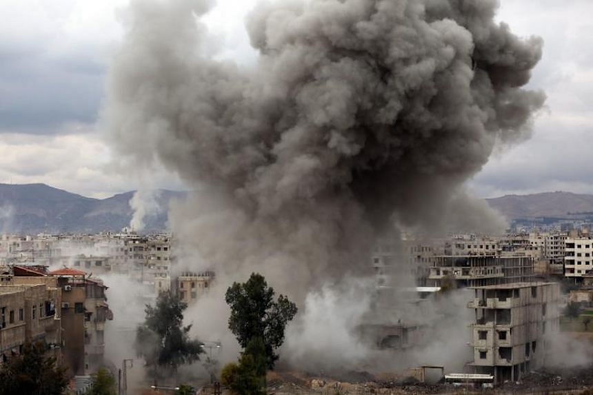 Smoke billows following Syrian government bombardments on Kafr Batna, in the besieged Eastern Ghouta region on the outskirts of the capital Damascus, on Feb 22, 2018.