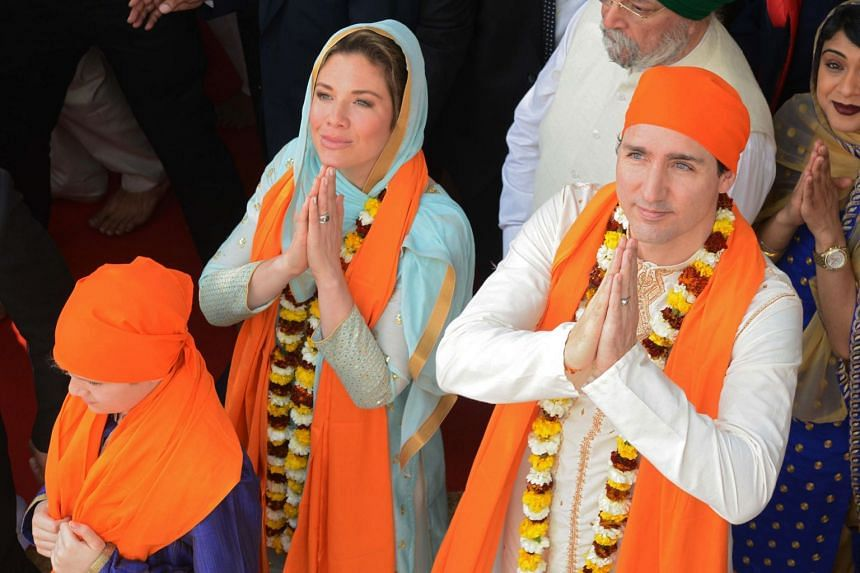 Canadian Prime Minister Justin Trudeau (right) with his wife Sophie Gregoire (left) pay their respects at the Sikh Shrine Golden temple in Amritsar, India on Feb 21, 2018.