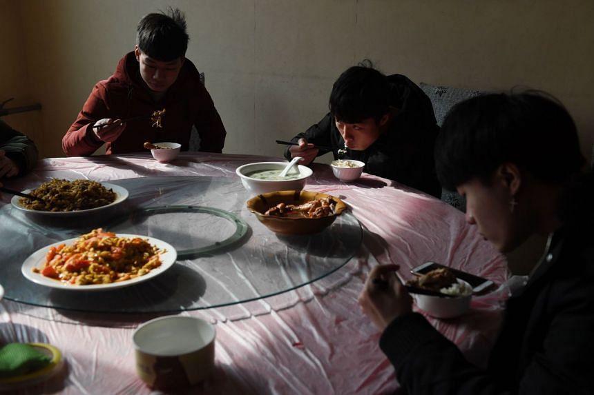eSports students eating lunch between classes at the Lanxiang technical school in Jinan, in China's eastern Shandong province.