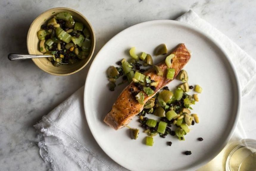 Pan-seared salmon with celery, olives and capers.